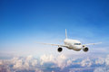 Flight, airplane flying in blue sky, travel background