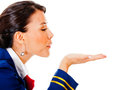 Flight attendant blowing in her hand Royalty Free Stock Image