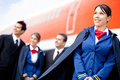 Flight attendant with cabin crew Royalty Free Stock Photo