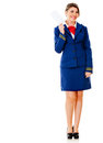 Flight attendant holding ticket Royalty Free Stock Images