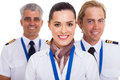 Flight attendant pilots beautiful standing in front of two Stock Photography