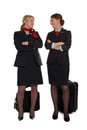 Flight attendants talking together Royalty Free Stock Photo