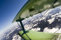 Flight on a biplane over the earth Royalty Free Stock Photography