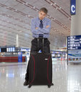 Flight delay sad businessman with a suitcase at the airport Stock Images