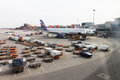 Flight field, Aeroflot aircraft and loading trucks before taking Royalty Free Stock Photo