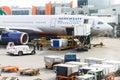 Flight field, Aeroflot aircraft and loading trucks before taking Royalty Free Stock Photo