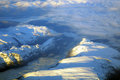Flight over fjords the snow covered norwegian view from the airplane Royalty Free Stock Images