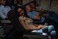 Flight passengers sleep plane cabin night travel Royalty Free Stock Photo
