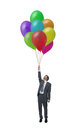 Flight picture businessman with many balloons in hand Stock Photos