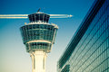 Flights management air control tower passenger terminal and flying plane Royalty Free Stock Photo