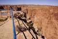 Flimsy blue rail overlooking the rim of the little grand canyon of the colorado river arizona Royalty Free Stock Photos
