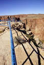 Flimsy blue rail overlooking the rim of the little grand canyon of the colorado river arizona Royalty Free Stock Photography