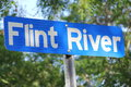 The flint river a blue sign for Royalty Free Stock Photo