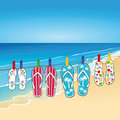 Flip flops on beach four pairs of hanging a line a Stock Image