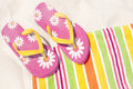 Flip flops on beach towel Royalty Free Stock Photo