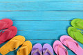 Flip flops with blue summer beach deck, copy space