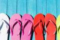 Flip flops colorful by a swimming pool Stock Photography