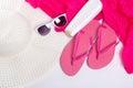 Flip flops hat sunglasses over white and cream Stock Photos