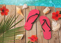 Flip flops and hibiscus flowers on wooden background. Summer holiday vacation concept. View from above Royalty Free Stock Photo