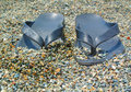Flip flops a pair of black fops on the beach Royalty Free Stock Photography