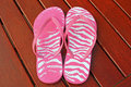Flip flops pink at the side of the pool beach Stock Photos
