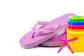 Flip flops, sand toys and seashells. Royalty Free Stock Photo