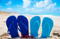 Flip flops with sign love on the sandy beach by the ocean Royalty Free Stock Photo