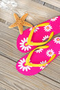 Flip flops and starfish on dock Royalty Free Stock Photo