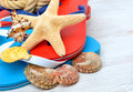 Flip-flops, starfish and seashells. Royalty Free Stock Photo