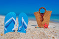 Flip flops and straw bag blue with on the background Royalty Free Stock Photos