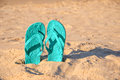 Flip flops stuck in the sand of a beach Stock Photography