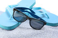Flip flops and sunglasses on the towel blue Royalty Free Stock Images