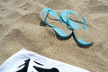 Flip flops and towel on the beach summer image Stock Image