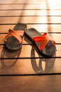 Flipflop on the deck in the evening light Stock Photo