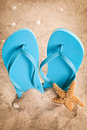 Flipflops and starfish Stock Images