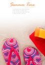Flipflops sunscreen towel on beach sand Stock Photos