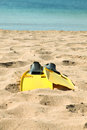 Flippers on beach pair of sandy Royalty Free Stock Image