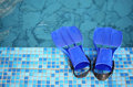 Flippers on the brink of pool Royalty Free Stock Photos