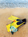 Flippers and a mask at the sea Royalty Free Stock Image