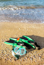 Flippers and a mask at the sea Royalty Free Stock Images