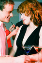 Flirt in a bar Royalty Free Stock Photos