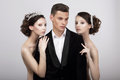 Flirtation. Handsome Man in Cuddle of Two Voluptuous Women Royalty Free Stock Photo
