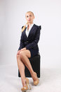 Flirtation at the office beautiful young girl blonde of european appearance is sitting on a chair and is interestedly looking her Stock Images