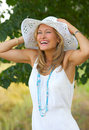Flirtatious portrait of a girl with a summer hat Stock Photos