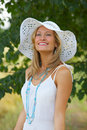 Flirtatious portrait of a girl with a summer hat Royalty Free Stock Photos
