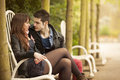 Flirting beautiful young couple on bench Royalty Free Stock Photo
