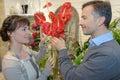 Flirting in flower shop Royalty Free Stock Photo