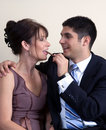 Flirting Formal Couple with Chocolate Stock Photos