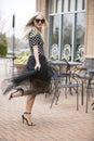 Flirty model in polka dots blonde dot shirts and sheer black skirt making flirtatious pose Royalty Free Stock Photo