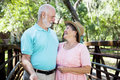 Flirty Senior Couple Outdoors Royalty Free Stock Photo
